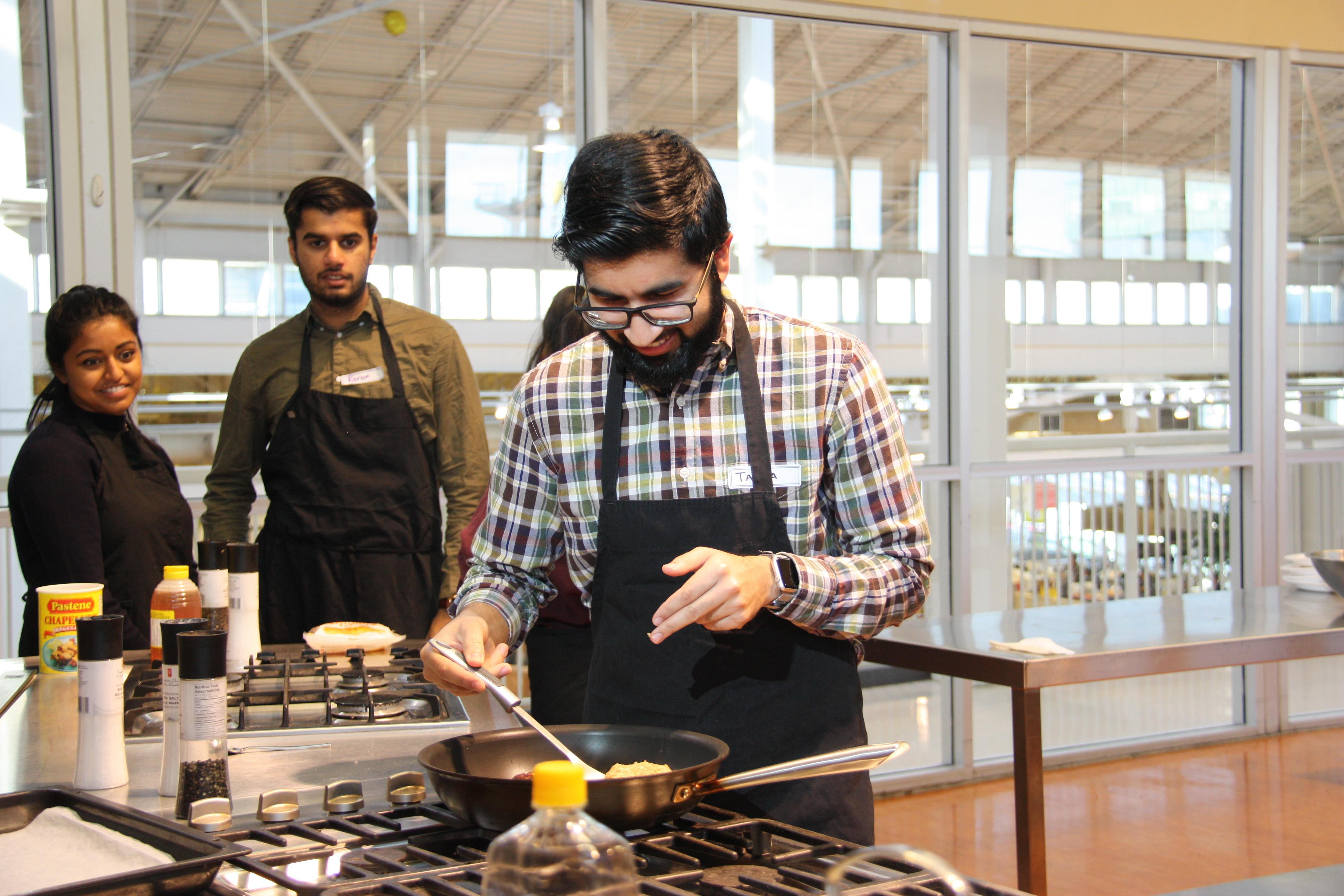 MEDICAL STUDENT TAAHA MUHAMMAD TRIES HIS HAND AT COOKING