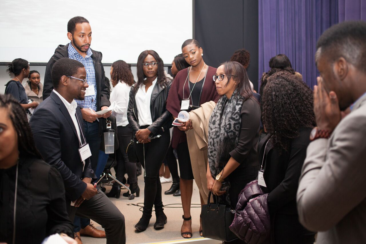 DR. AYO ODUTAYO SPEAKS WITH STUDENTS.